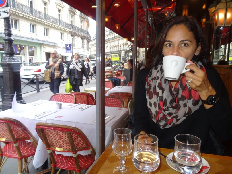 Enjoying a cappuccino in Paris cafe.